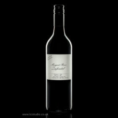 Wine bottle on a black background –  Product photography
