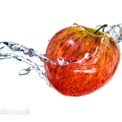Apple wrapped in water splash – Liquid splash photography