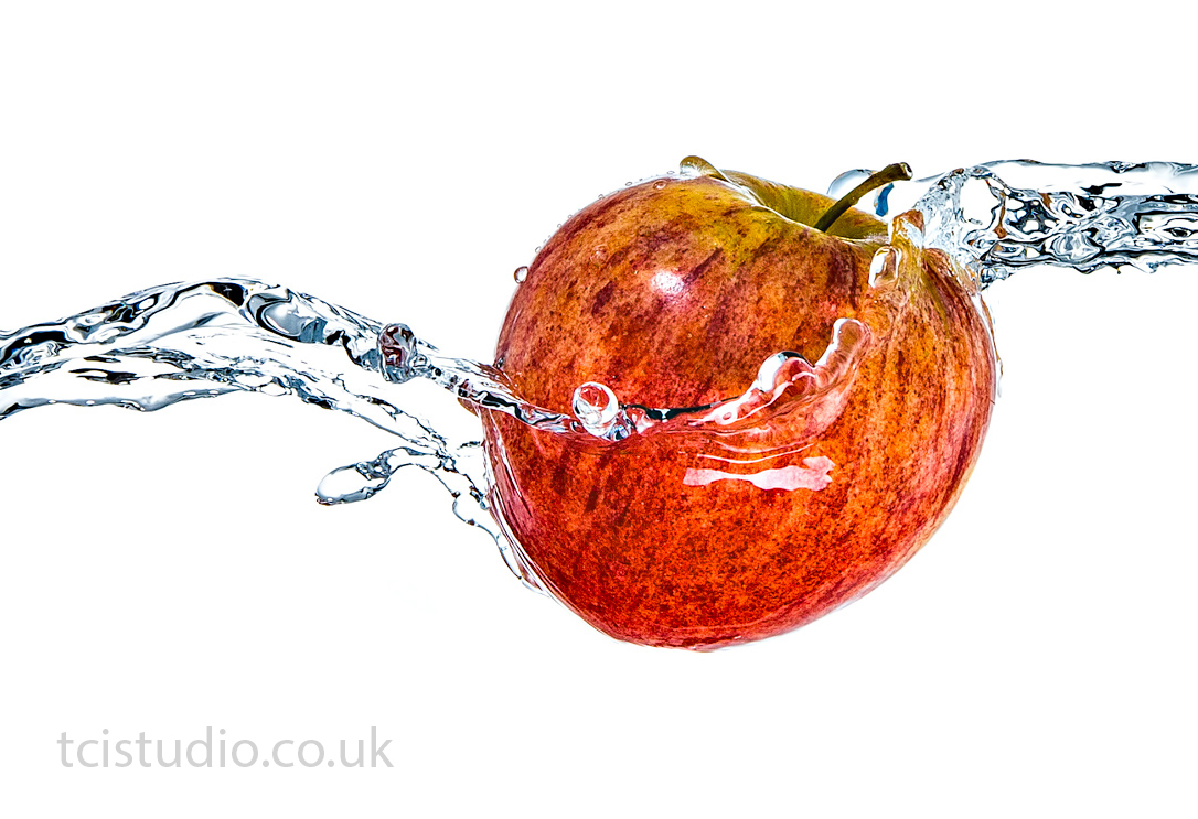 An apple water splash photograph