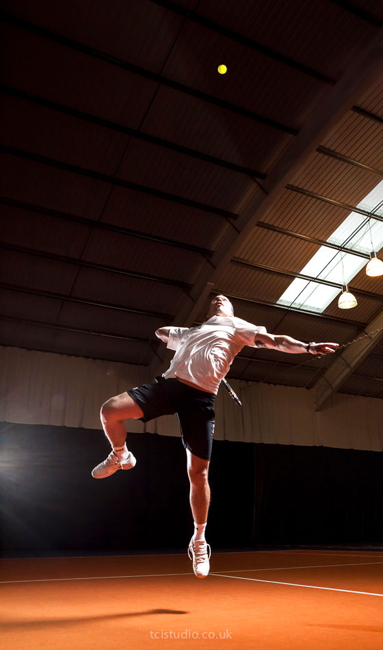 sports portraits, tennis action photography slam dunk smash shot of Attila, tennis coach at the David Lloyd centre Cambridge Uk