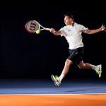 tennis action photography running forehand shot, Oli, tennis coach at the David Lloyd centre Cambridge Uk