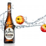 liquid photography and Graphic Art of Aspall Cyder bottle and apples with liquid splash